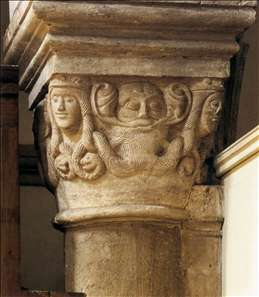Capital with bearded mask and heads