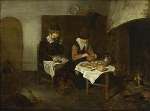 A Couple Having a Meal before a Fireplace